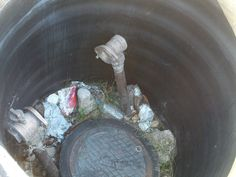 PT 7 OCT 13 LOOK AT THE DIFFERENT TRASH IN THE WATER THING IN NAMPA IDAHO.