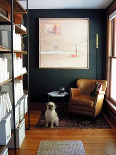 CW - I love the juxtaposition of the dark wall color/rug/leather with the light pink feminine artwork! Works so well with the brass accents too ;)
