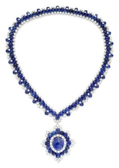 VAN CLEEF & ARPELS. A MAGNIFICENT SAPPHIRE AND DIAMOND CONVERTIBLE NECKLACE. Designed as a series of cabochon sapphires embellished to either side with arches and accents of brilliant-cut diamonds and further cabochon sapphires, the necklace suspending a pendant composed of a central cabochon sapphire weighing 23.75 cts, within a radiating stylized foliate motif set with graduated oval-shaped cabochon sapphires and brilliant-cut diamonds, circa 1966 Price:£360,000