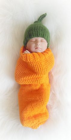 Pumpkin Cocoon Set. Made with acrylic yarn. Wash on regular cycle low heat. Knot top hat is newborn size. Cocoon measures approximately 18 1/2in