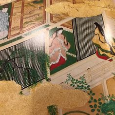 Heian era ukiyo-e print of 2 women dressed in junihitoe and a man dressed in kariginu