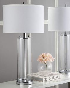 Brighten any space in your home or office with the Safavieh Velma Table Lamp. This elegant lamp offers sleek sophistication with its contemporary chrome detail, glass base, and off-white cotton drum shade. White Table Lamp, Table Lamp Sets, Glass Table Lamps, Shabby, Modern Glass, Drum Shade, Art Deco Fashion, Clear Glass, White Cotton
