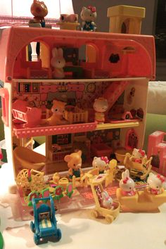 Hello Kitty Dollhouse with furniture and Sanrio characters.