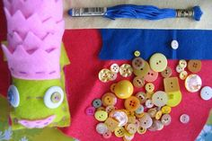 Kids sew their own creature design. Felt, embroidery thread, buttons, etc.