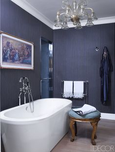 Architect Achille Salvagni transformed this Roman Palazzo into a storied bathroom, featuring tub fittings by Lefroy Brooks, a heirloom 1750 Italian stool, and a 1930s Venini chandelier. The striped wallpaper is by Ralph Lauren Home. Find the full tour here. Simon Upton - ELLEDecor.com