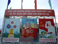 Ho Chi Minh City. Posters celebrating defeat over the French forces at Dien Bien Phu 50 years ago.  General Vo Nguyen Giap led the Vietnminh army of communist leader Ho Chi Minh in a historic 55-day siege of French forces at Dien Bien Phu, in the north of the country.  The siege ended when the French troops, worn down by constant artillery barrages and unable to resupply by air, surrendered on May 7, 1954.