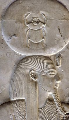 """the God Ra-Harakhty, human-headed, wearing the Solar disk with the Uraeus. Inside the Sun is represented the sacred scarab of the God Khepry. """"Great Temple"""" of King Sethi I at Abydos, Inner Shrine of..."""