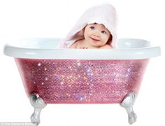 Squeaky-clean: This Swarovski-encrusted baby bath, $3,800, comes in a variety of colors - its makers say once the child has outgrown it, it can be used as an ice bucket for drinks or a pet bath