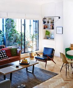 The Surry Hills apartment of Virginia Mesiti and Scott Otto Anderson, and one year old August.  Vintage Børge Mogensen leather lounge, Poul Jensen Z-Chair, designed for Selig in the 60′s – Scott says 'I eventually found another one of these chairs to make a pair but Gin made me put it in the studio as she felt we had enough seating already :( 'Virginia responds –  At the time we counted seating for 35 ppl in our living room!'.