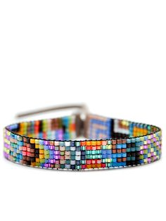 Image from http://cdn.shopify.com/s/files/1/0125/8122/products/julie_rofman_tiny_beaded_bracelet_in_palermo_1024x1024.jpg?v=1344098180.
