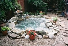 this is such an awesome outdoor hot tub. it looks like a hot springs or something