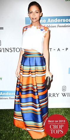 Also at the gala, Nicole Richie took to the midriff-baring trend with a bold Alberta Ferretti ensemble that comprised a flower-adorned crop top and a multicolored stripe maxi skirt, accessorizing with a smattering of rings and a black clutch.