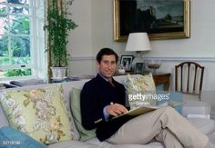 Prince Charles Sitting In His Living Room At Home In Highgrove House.