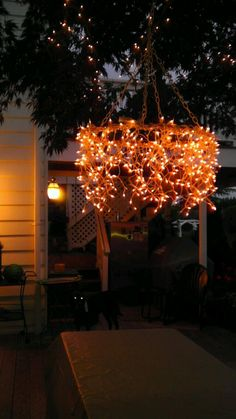 Hula hoop chandelier over picnic table.