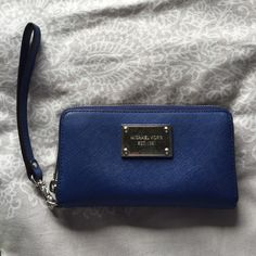 Michael Cors Cobalt Blue wallet/clutch Barely used in good condition! Adds a pop of color to an outfit Michael Kors Bags Clutches & Wristlets