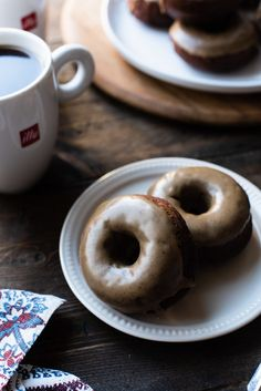 You need a treat to go with your coffee - make some Coffee-Glazed Baked Chocolate Doughnuts! This easy baked doughnut recipe is made with dark chocolate and rich, bold coffee — perfect for coffee lovers! No Dairy Recipes, Baking Recipes, Dessert Recipes, Desserts, Bread Recipes, Baked Doughnut Recipes, Baked Doughnuts, Homemade Pastries, Coffee And Donuts