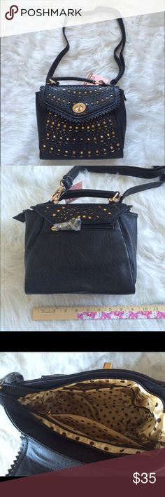Melie Bianco Sophia Crossbody Purse NWT. Faux leather. Turn lock closure. Top handle. Adjustable and detachable crossbody strap with drop length of approximately 22 inches. Offers and questions are welcome. No trades. Melie Bianco Bags Crossbody Bags