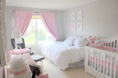 Ultra-feminine, soft look to this elegant pink and grey nursery.