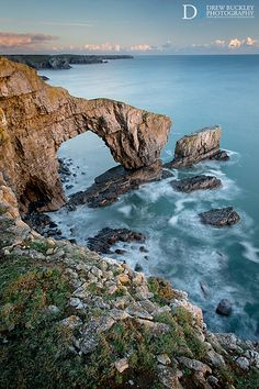 The last rays of sunlight on a winter's afternoon illuminate the rocky face of the 'Green Bridge' natural sea arch in Pembrokeshire, Wales Wales Uk, South Wales, Pembrokeshire Coast, Dylan Thomas, Robinson Crusoe, Road Trip, Thinking Day, England And Scotland, Cardiff