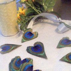 Heart-shape peacock feathers <3