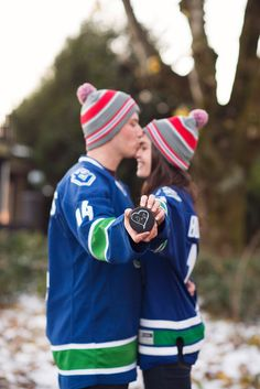 Think they're hockey lovers? Ha. Super cute and cozy Winter Engagement Photo Shoot from Canada.