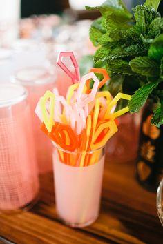 orange and yellow drink stirrers
