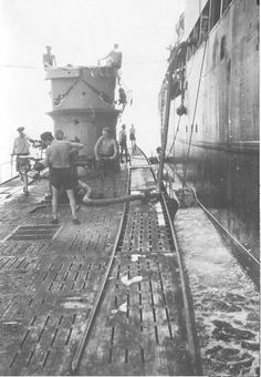 German sub U-106 (Type IXB) refueling at sea.