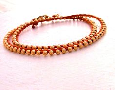 Woven waxed linen and gold beaded necklace by MStreetStudio, $100.00