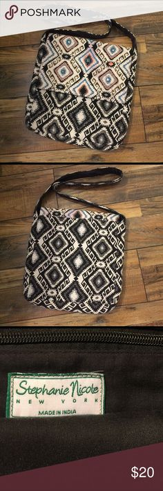 Stephanie Nicole Crossbody Beautiful cloth Boho Crossbody.  Cute, clean, no holes, rips or stains.  Interior backwall zip pocket and magnetic closure. It has the Free People look but not the price. Stephanie Nicole Bags Crossbody Bags