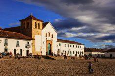 Villa de Leyva, Colombia: 16th Century church on plaza; people stock photo