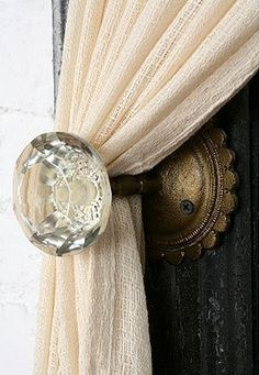 Doorknobs to hold curtains back keeps the rustic glam feel of a Tuscany Homes #tuscanyhomesnw www.tuscanyhomesnw.com