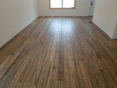"This is our Plantation Ash floor. It is 5"" Ash that has a two tone stain and has been wire brushed. It is in Schroon Lake, NY."