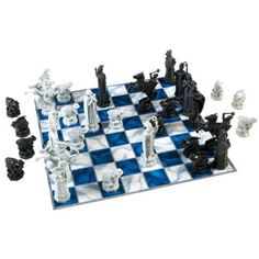 $29.99 - Wizards and Muggles alike will enjoy the timeless game of chess with this Harry Potter set.  The set comes with detailed plastic replicas of the Wizard Chess pieces seen in Harry Potter and the Sorcerer?s Stone. r• Board measures approximately 14 by 14 with r•  Kings measuring approximately 4 1/4 tall. rrContents of Harry Potter Chess Set:r•  Chessboard, r• 32 Chess Pieces (16 Black, 16 White)  r• 1 Instruction Sheet.