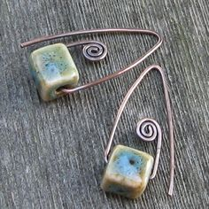 Another selection from my collection Ive titled Small Statements...they are a little more petite than some of my other earrings, but they still make a powerful statement! These little beauties feature ceramic cubes hung on 18 gauge copper earwires. The beads have teal, blue, green,