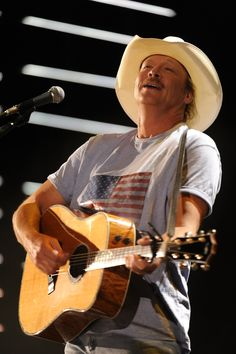 Alan Jackson-- My first Celebrity crush.   He made me sweat as a child.