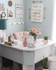 This is such a pretty, feminine office space. The pink chair is such a beautiful piece in the room! The prints on the wall behind are a perfect compliment to the space.