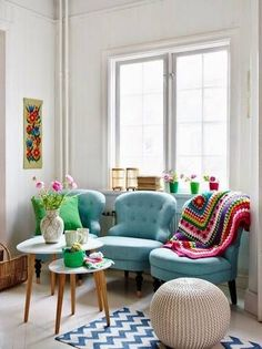 A quirky collection of chairs is one way to get enough seating without bringing in a large sofa.