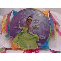 Princess Tiana & Frog Party Pinata by Unique. $28.99. Party Pinata. The pinata is an 18 inch round and 4 inches wide  Cab be broken by using a stick or pulling the attached pull strings  Will hold 6 pounds of candy or small treats   Handy heavy duty plastic loop attached on top of the pinata for hanging it