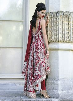 Red and silver with a deep back v-neck - for more follow my Indian Fashion Boards :)