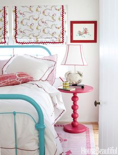 "She chose turquoise and red for her 10-year-old niece's bedroom because ""they're always great together."" A Bubble-Up side table from PB Teen is paired with the vintage painted bed.   - HouseBeautiful.com"