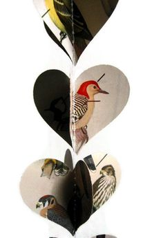 This heart garland is made from a vintage field guide to birds. I love the illustrations and they look great cut into heart shapes on these