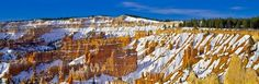Fresh snow winter panorama photo of the natural amphitheater with its hoodoos in Bryce Canyon National Park in Utah, USA.