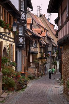 Quaint street in Eguisheim, Alsatian Wine Road, Haut Rhin, Alsace, France, Europe
