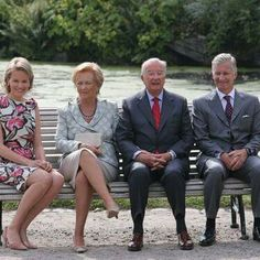 King Albert II and Queen Paola of Belgium sit with the new King Phillipe and Queen Mathilde of Belgium