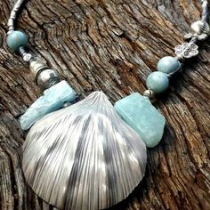 #Repost @shimarah_jewelry  I have had a lot of requests for sterling silver lately!  Ask and you shall receive  Hill Tribe Silver & Aquamarine adjustable necklace. This piece can be worn long or short and features a stunning Hill Tribe silver shell pendant and a variety of engraved Hill Tribe Silver beads interwoven with genuine aquamarine crystal all finished on a grey 100% waxed cotton plaited cord. $100  #aquamarine #sterlingsilver #hilltribesilver #handmadejewelry #handmadejewellery…
