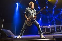 Rick Parfitt performs on stage at O2 Arena in London on 19 December 2014