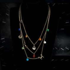 Wear the galaxy around your neck with this tiered planetary necklace. Three strands on a single clasp lay out the major planets - and it's a gorgeous look. Pick yours up from . Id Bracelets, Braided Bracelets, Watch Necklace, Bracelet Set, Star Wars Planets, Star Wars Jewelry, Layered Necklace Set, Letter Beads, Strands