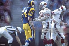 NFC playoffs, Los Angeles Rams Merlin Olsen (L) upset with St, Louis Cardinals Conrad Dobler (R) during game, Los Angeles, CA