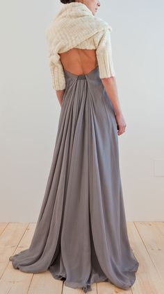 Love the back of this dress! I wonder if I could get a maxi-dress, take off the top part(so it'll be longer) and sew it like this, adding some sort of top to make it a dress... hmmm