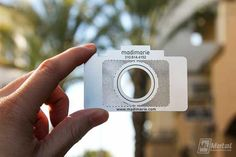 camera-shaped metal business card for a photographer.